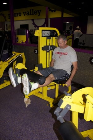 Planet Fitness: Scott Beatty work outs in the 30-minute workout area at the new Planet Fitness in Oro Valley.  This is the second Planet Fitness to open in Tucson.  - Hannah McLeod/The Explorer