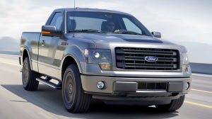 2014 Ford F-150 Tremor: The new 2014 Ford Tremor boasts distinctive looks complemented by unique box-side Tremor graphics and plenty of power under the hood. - Ford Motor Company