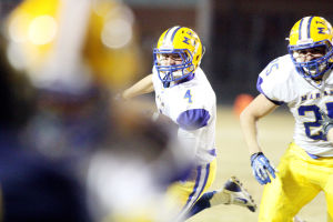 Marana Vs Flowing Wells Football: Marana senior Ross Jonathon keeps his eyes on the defense as he takes the ball in for six points early in the game. - Randy Metcalf/The Explorer