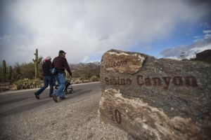 Two Miles Every Day: Rick Metcalf sets out up Sabino Canyon with his daughter-in-law Caryn Metcalf and her son Lincoln. Rick walked two miles every day during 2012.  - Randy Metcalf/The Explorer