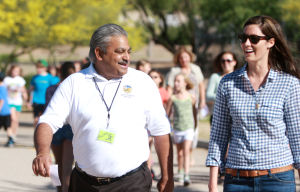 Painted Sky Elementary School's Miler's Club: Oro Valley Mayor Satish Hiremath talks with Painted Sky Elementary School fourth-grade teacher Brie Ronnie during the bi-weekly Miler's Club get-together.  - Randy Metcalf/The Explorer