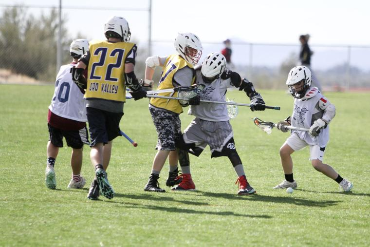 Oro Valley Lacrosse Club 12U - fighting for the ball.jpg