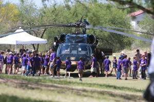 Drug Awareness Day: Students surround the U.S. Border PatrolÕs Blackhawk helicopter during the annual Drug Awareness Day in Oro Valley last week.  - Randy Metcalf/The Explorer