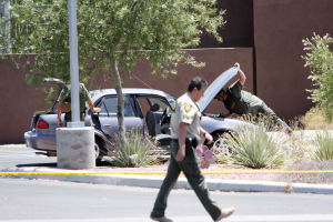 Suspicious Package: The Pima Regional Bomb Squad responded to the Northwest Fire District's station at the corner of Ina and Shannon roads in response to a report of a suspicious package in a car. The package turned out to be a laptop.  - J.D. Fitzgerald/The Explorer
