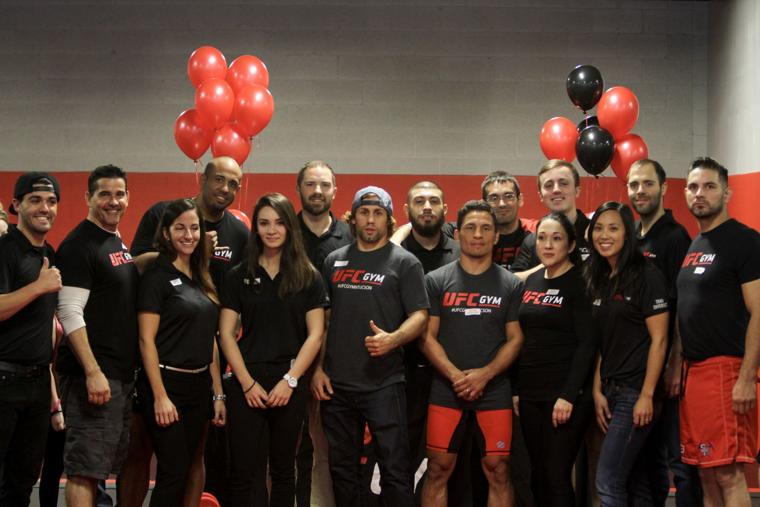 Faber and Benavidez with the UFG Gym staff.jpg