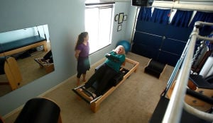 Jennas Pilates: Jenna Morris works with a client in her personal Pilates Studio in the Dove Mountain area. Morris started her own business, Jenna's Pilates and Dance in 2008, where she brings her 17 years of dance experience and formal Joseph Pilates training to her clients.  - Randy Metcalf/The Explorer