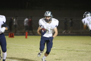 Ironwood Ridge Nighthawks: Cole McLafferty runs the ball for the Nighthawks in the second half.  - Jon Grimes/Special to The Explorer