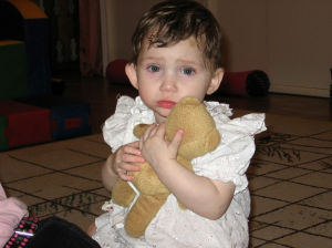 Adoption Series Week 2: Abby holds a teddy bear at the orphanage she stayed at in Russia. Pam Freeman says that Abby cried a lot when they first met her.