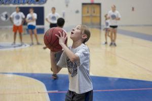 IRHS Summer Basketball: DoriaRose Lukasik-Dresch, a third grader, gets ready to shoot the ball during the spot drill.  - Hannah McLeod/The Explorer