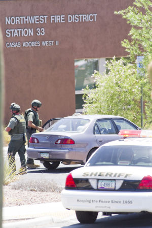 Suspicious Package: The Pima Regional Bomb Squad responded to the Northwest Fire District's station at the corner of Ina and Shannon roads in response to a report of a suspicious package in a car. The package turned out to be a laptop.  - Randy Metcalf/The Explorer