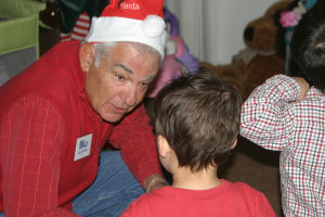 Give To Win A Success For Families: Steve Pollyea of Interfaith Community Services talks to Caleb about Santa Claus and Christmas - Thelma Grimes/The Explorer