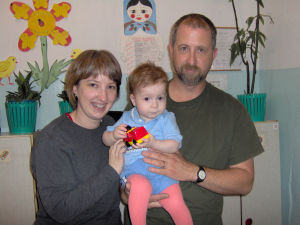 Adoption Series Week 2: Pam and Brian Freeman hold Benjamin for the first time. Benjamin was found abandoned on March 18, 2004, the exact day that the Freeman's decided that they wanted to adopt.