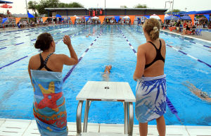 Oro Valley Open Swim Meet: Marana swimmers Lina Ortiz, left, and Kiera Lamorenux, right, cheer on their fellow swimmer Hope Nolin during the Oro Valley Open swim meet. The meet ran from Friday to Sunday - Randy Metcalf/The Explorer
