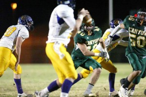 Dorados Post 56 Points… In A Half : Randy Metcalf/The Explorer, Canyon Del Oro linebacker Bobby Henkel, 40, and defensive lineman Andy Carter, 50, put the pressure on Peoria Sunrise Mountain quarterback Josh Ackerman-Blake during Friday night's game. The Dorados, who are ranked No.1, defeated the 16th-ranked visitors 56-35.