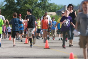 Painted Sky Elementary School's Miler's Club: More than a hundred students, teachers and parents walk and run during the MilerÕs Club at Painted Sky Elementary School.  - Randy Metcalf/The Explorer