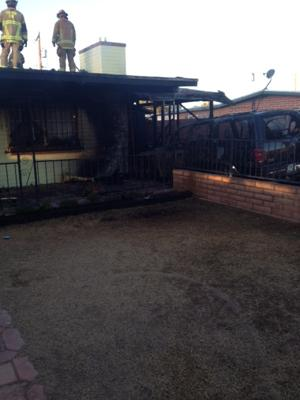 Fire displaces five residents after carport fire