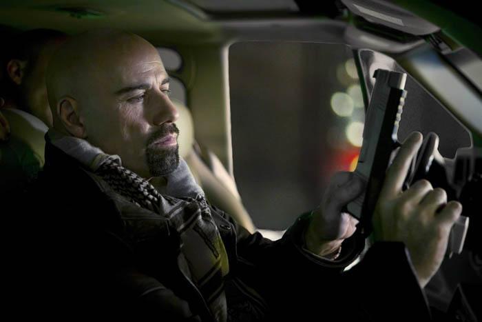 Travolta plays action hero in 'Paris'