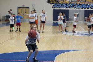 IRHS Summer Basketball: Third grader DoriaRose Lukasik-Dresch prepares to shoot the ball from the elbow.  - Hannah McLeod/The Explorer