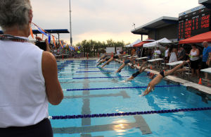 Oro Valley Open Swim Meet: Starter Judy Gillies begins one of the races June 28 at the Oro Valley Aquatic Center. - Randy Metcalf/The Explorer