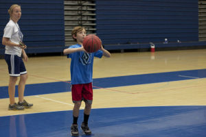 IRHS Summer Basketball: Ethan Tees, a fifth grader, shoots the ball in the spot game at the Ironwood Ridge basketball camp.  - Hannah McLeod/The Explorer