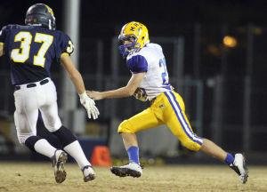 Marana Vs Flowing Wells Football: Nathan Sakuta flanks across the field as he takes the ball down the field. - Randy Metcalf/The Explorer