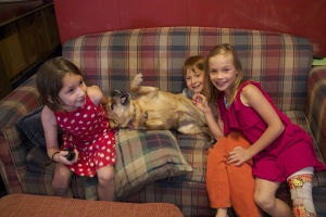 Russia Adoption: Abby (left), Benjamin (middle) and Libby (right) play with their dog at home. - Hannah McLeod/The Explorer