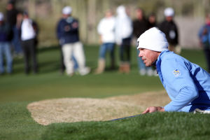 Final Round Of The Accenture Match Play Championship: Matt Kuchar lines him his putt from the vantage point of the sand trap on the 16th.  - Randy Metcalf/The Explorer