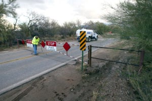 Road Closure: Roads were reopened on Monday after flooding caused problems in north Tucson Saturday.  - Randy Metcalf/Explorer Newspaper