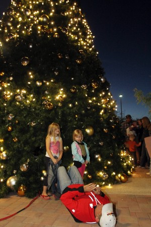 Oro Valley Holiday Tree Lighting: Chris Phillips gets a photo of the Oro Valley Christmas Tree and his daughters Campbell, 6, left, and Kennedy, 4.  - Randy Metcalf/The Explorer