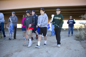 Xpress Baseball: Eli Pallanes (left), Quinn McKearney, Cole Madril and Rylund Gonzales (right) walk in the Canada Del Oro wash. The club baseball time has volunteered to adopt the wash and will be responsible to clean it at least twice a year. - Hannah McLeod/The Explorer