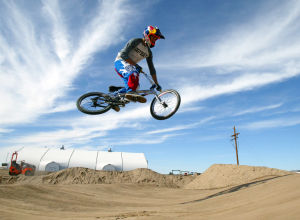 Xtreme Fun Spot At Sports Park: Professional BMX rider Corben Sharrah takes a spin on the new BMX course at Sports Park's Xtreme Fun Spot. The park is expected to be open to public within the next month.  - Randy Metcalf/The Explorer