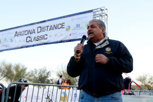 Arizona Distance Classic: Oro Valley Mayor Satish Hiremath speaks to the racers before the start of the Arizona Distance Classic Sunday,  - Randy Metcalf/The Explorer