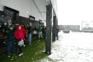 Accenture Match Play Championship: On Wednesday, golf spectators seek coverage under the awning of a concession stand as snow began to fall after rounds of golf were cancelled for the day.  - Randy Metcalf/The Explorer