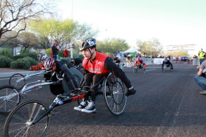 Arizona Distance Classic: Racers in the wheelchair division of the half marathon take off down the opening stretch during Sunday's race.  - Randy Metcalf/The Explorer