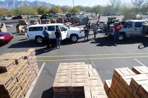 Girl Scout Cookies: Three semi trailers of cookies were unloaded into the parking lot of Casas Church for pick up last week. - Randy Metcalf/The Explorer