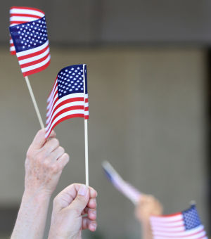 "Flag Day: Flags are waved during the song, ""God Bless the USA.""  - Randy Metcalf/The Explorer"