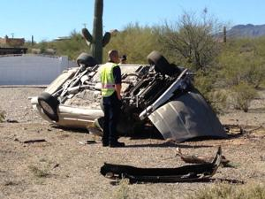 Silverbell Road closed due to rollover accident