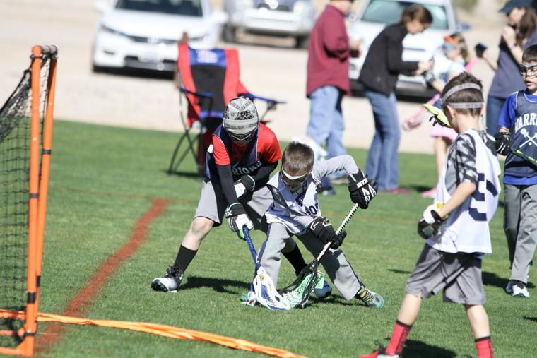 Oro Valley Lacrosse Club 8U - fighting for the ball.jpg