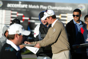 Accenture Match Play Championship Warm Ups: Justin Rose of England signs autographs as he makes his way to the driving range.  - Randy Metcalf/The Explorer Newsp