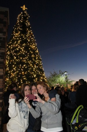 Oro Valley Holiday Tree Lighting: Alexis, left, Talia, middle, and Jennifer Johnson, right, take a picture of themselves in front of the Oro Valley Christmas Tree.  - Randy Metcalf/The Explorer