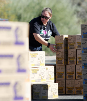 Girl Scout Cookies: Lauren Portner readies an order of Girl Scout cookies for pick up. - Randy Metcalf/The Explorer