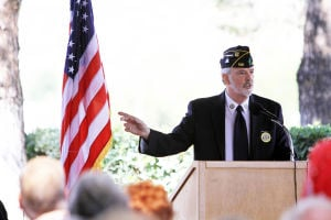 Flag Day: American Legion Post 132 Commander Ed Davis speaks during the Flag Day ceremony last Friday in SaddleBrooke.  - Randy Metcalf/The Explorer