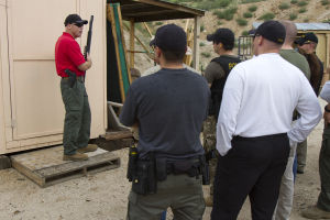 Active Shooter Training: Sgt. Robert Goddard explains to Oro Valley police officers about the angles they should take with shooting a lock off of a door at the Pima Pistol Club. - Randy Metcalf/The Explorer