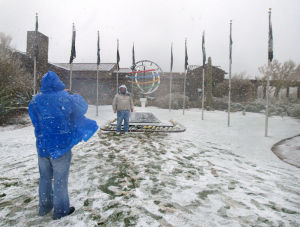 Accenture Match Play Championship Day 1: As people made their way to the busses after the Accenture Match Play Championship golf was postponed, and eventually cancelled for the day, the stopped to get a photo in front of the Accenture sculpture.  - Randy Metcalf/The Explorer