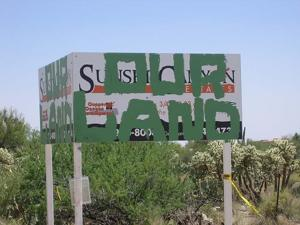Vandals deface sign at construction site