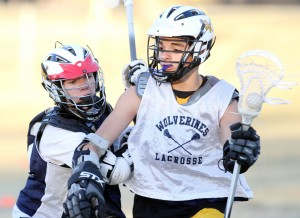 Oro Valley Lacrosse Club: Mike Rossetti, right, drives towards the goal as Nick Andress tries to block.  - Randy Metcalf/The Explorer