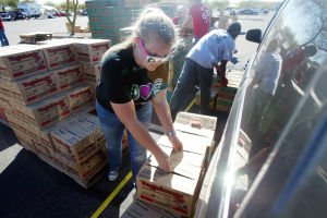 Girl Scout Cookies: Randi Jager readies an order of Girl Scout cookies for pick up. - Randy Metcalf/The Explorer