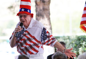 "Flag Day: Norm Beasley sings, ""God Bless the USA"" during the Flag Day ceremony last Friday in SaddleBrooke.  - Randy Metcalf/The Explorer"