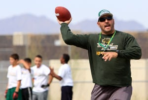 Dorado Camp Of Champions: Head CDO football coach Dustin Peace passes the ball during the summer football camp held last week.  - Randy Metcalf/The Explorer