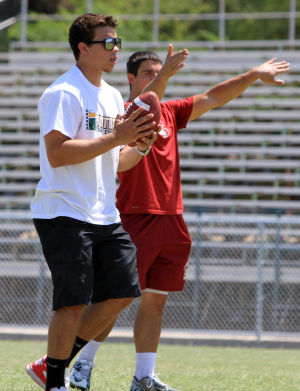 Dorado Camp Of Champions: Former Canyon Del Oro High School football players Jared Tevis, front, and Blake Martinez help out at the school's summer football camp for sixth, seventh and eighth graders.  - Randy Metcalf/The Explorer